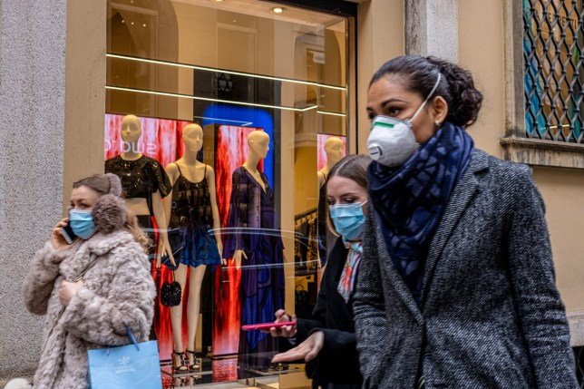 people shopping with face masks on in milan amid the coronavirus outbreak