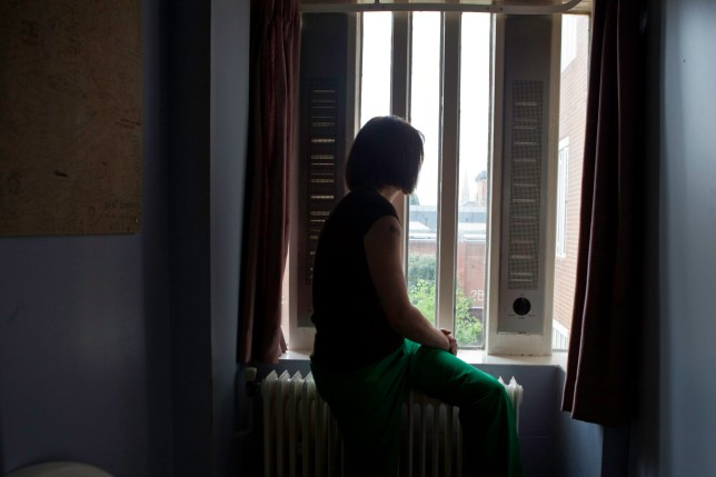 A female prisoner sitting on her bed in the first night (4 person) dorm at HMP Holloway, the main womens prison in London. HM Prison Holloway (sometimes known as Holloway Castle) is a closed category prison for adult women and Young Offenders, located in the Holloway area of the London Borough of Islington, in north and Inner London, England. The prison is operated by Her Majesty's Prison Service. Holloway Prison holds female adults and young offenders remanded or sentenced by the local courts. Holloway prison offers both full-time and part-time education to inmates, with courses including skills training workshops, British Industrial Cleaning Science BICS, gardens and painting. There is a family-friendly visitor centre at Holloway, run by the Prison Advice & Care Trust (pact), an independent charity. (Photo by In Pictures Ltd./Corbis via Getty Images)