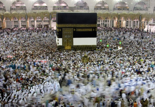 FILE - In this Aug. 7, 2019, file photo, Muslim pilgrims circumambulate around the Kaaba, the cubic building at the Grand Mosque, ahead of the Hajj pilgrimage in the Muslim holy city of Mecca, Saudi Arabia. Saudi Arabia on Thursday, Feb. 27, 2020, halted travel to the holiest sites in Islam over fears of the global outbreak of the new coronavirus just months ahead of the annual hajj pilgrimage, a move coming as the Mideast has over 220 confirmed cases of the illness. (AP Photo/Amr Nabil, File)