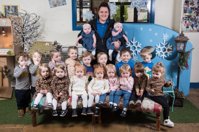 Steph Doxsey holding her twin daughters Gracie Catterall, both 5 months. Back row: Tobias & Arlo McHugh, 2, Rey & Joanie Layton, 4, Chloe & Emily Worrall, 3, Archie and Ben Lowther, 4. Front row: Elizabeth & Olivia Handby, 22mo, Penelope & Grace McMahon, 1, Sadie & Lottie Dean, 2, Sia & Ava Vivaldi, 2