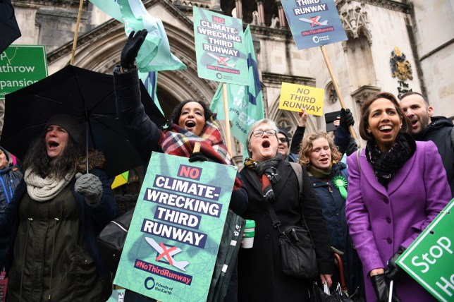 "Campaigners cheer outside the Royal Courts of Justice in London where Lords Justice Lindblom, Singh and Haddon-Cave, said during a Court of Appeal ruling on the Heathrow expansion row that the Government did not take enough account of its commitment to the Paris Agreement on climate change when setting out its support for the proposals in its National Policy Statement (NPS). PA Photo. Picture date: Thursday February 27, 2020. In a summary of the ruling, Lord Justice Lindblom told a packed court: ""The Paris Agreement ought to have been taken into account by the Secretary of State in the preparation of the NPS and an explanation given as to how it was taken into account, but it was not."" See PA story COURTS Heathrow. Photo credit should read: Stefan Rousseau/PA Wire"