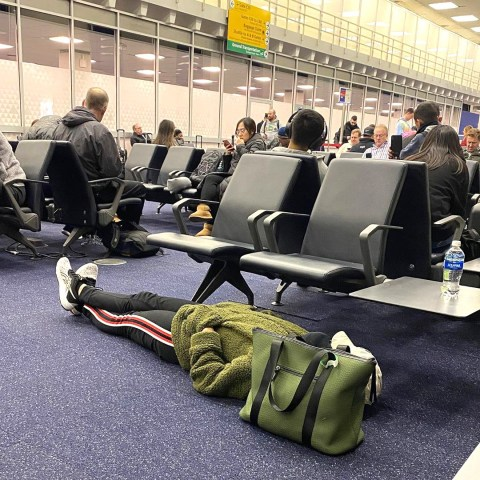 Traveller bashed for snoozing on airport floor – but is she in the ...