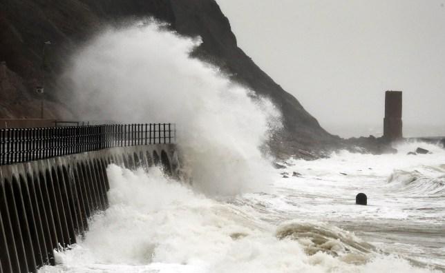 Waves crash against promenade as Storm Jorge hits Britain