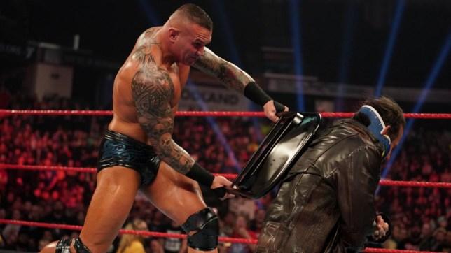 WWE superstar Randy Orton attacks Matt Hardy with a chair on Raw