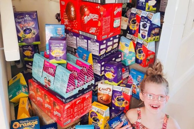 Little girl with 150 boxes of easter eggs