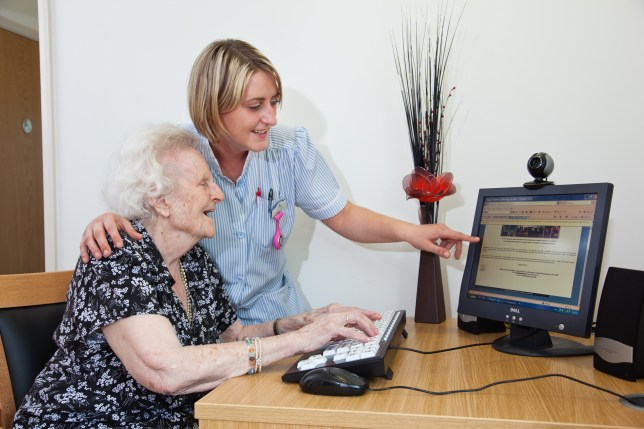 A carer helping a resident to get involved