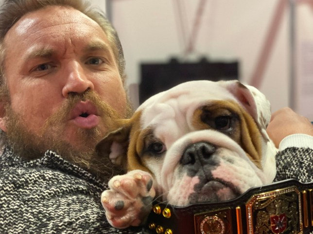 WWE's NXT UK superstar Trent Seven poses with Crufts dog