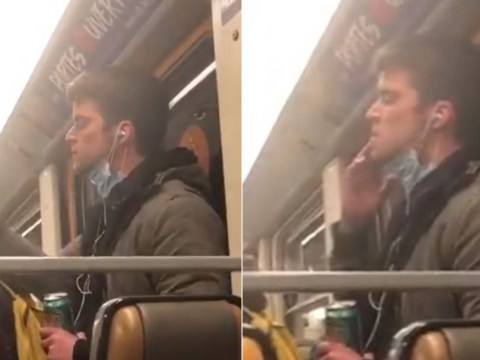 Man licks fingers then wipes them up and down handrail on train
