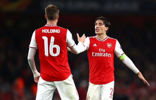 Rob Holding and Hector Bellerin celebrate Arsenal's Carabao Cup win over Nottingham Forest