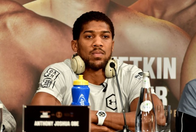 Anthony Joshua listens to questions at a press conference