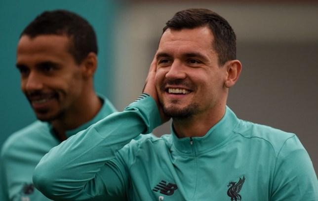 Dejan Lovren smiles in Liverpool training