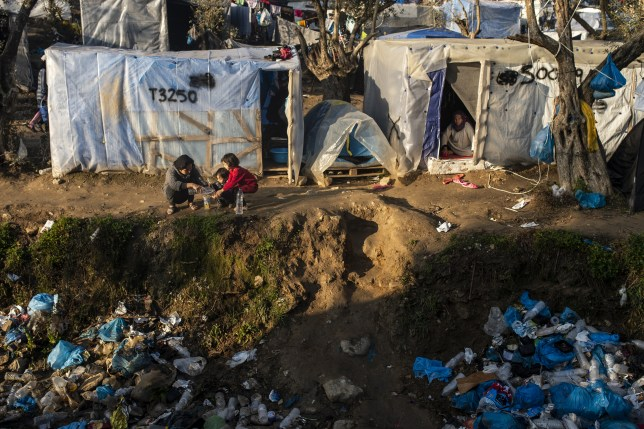 Children play amongst rubbish at the Moria refugee camp in Greece