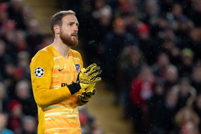 Jan Oblak adjusts his gloves during a game against Liverpool
