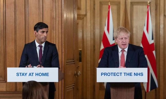 Britain's Prime Minister Boris Johnson and Britain's Chancellor of the Exchequer Rishi Sunak