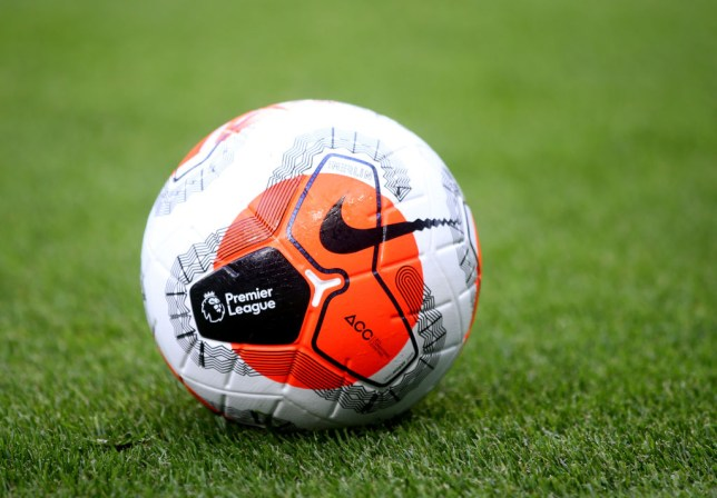 A premier League ball on the grass before a game