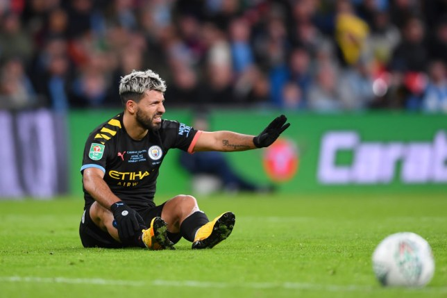 Sergio Aguero limped out of Manchester City's win at Wembley (Picture: Getty)