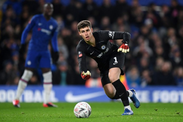 Kepa Arrizabalaga throws the ball to a Chelsea team-mate playing against Liverpool