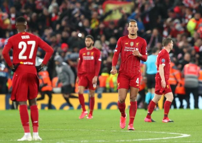 Virgil van Dijk and his Liverpool team-mates are dejected after conceding a goal