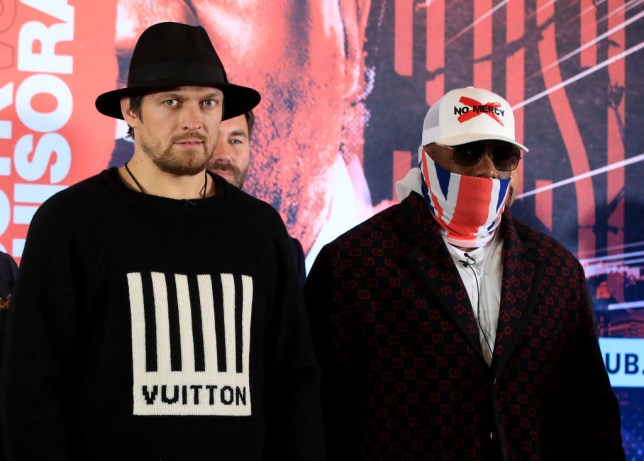 Oleksandr Usyk poses for pictures with heavyweight rival Derek Chisora
