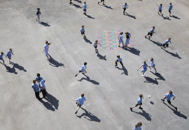 children running on playground.