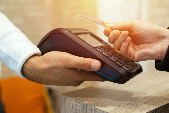 Contactless payment card being used