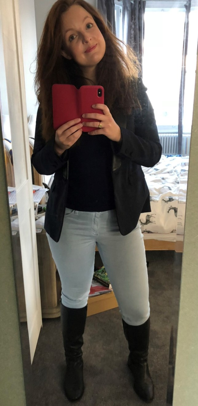 Kate in blue jeans, navy blazer and jumper