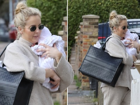 Lydia Bright looks so in love as she cuddles newborn daughter while heading out to see friends