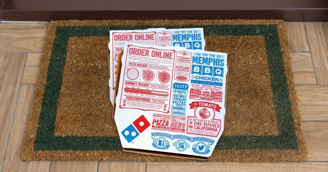 Dominos boxes on doorstep