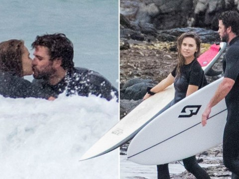 Liam Hemsworth stops for a kiss with girlfriend Gabriella Brooks while surfing amid coronavirus