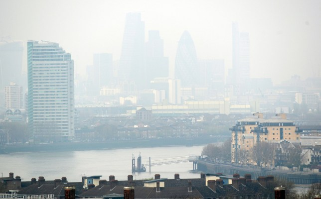 Dust particles and pollution from cars hangs over London, seen from Greenwich, as people suffering the effects of high levels of pollution.