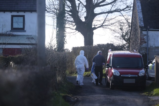 Forensic officers at the scene of a major incident at a farmhouse in Bankhall Road, Larne PA Photo. Picture date: Monday March 2, 2020. Sources have said a young child has died and another child and a woman have sustained serious injuries. See PA story ULSTER Larne. Photo credit should read: Niall Carson/PA Wire