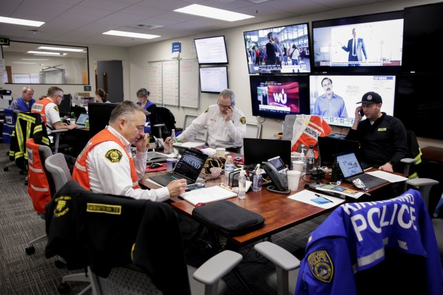 Kirkland Deputy Fire Chief Dave Van Valkenburg works as fire, police and city staff coordinate their response to the coronavirus (COVID-19) at the city's Emergency Operations Center in Kirkland, Washington, U.S. March 2, 2020. REUTERS/Jason Redmond