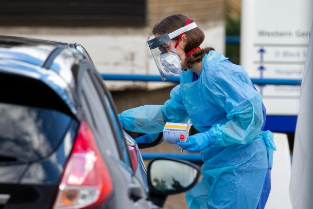 03/03/2020 Picture Duncan McGlynn +447771370263. Medical staff swab members of the public in their car at a ???drive through??? testing facility for Coronavirus at the Western General Hospital in Edinburgh, Scotland. ??Duncan McGlynn ***NO SYNDICATION***NO ARCHIVE***