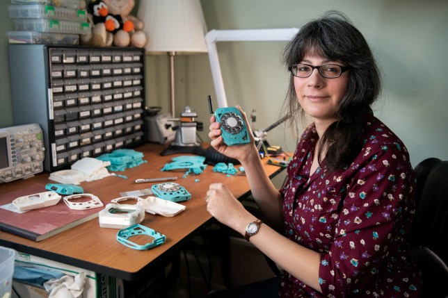 Space engineer Justine Haupt, 34, has created a rotary dial mobile phone due to her dislike of the hyper connectivity associated with the smartphone generation of phones. See SWNS story SWNYphone. A space engineer has built her own cell phone with a ROTARY DIAL because she despises smartphones and texting. Justine Haupt, 34, spent three years creating the old school device which fits into her pocket with a battery that lasts up to 30 hours. When she wrote about the retro cell phone on her website, so many people visited the post that her site crashed. Justine has since been inundated with requests from fellow smartphone haters begging for their own version of the phone and she is now offering build-it-yourself kits.