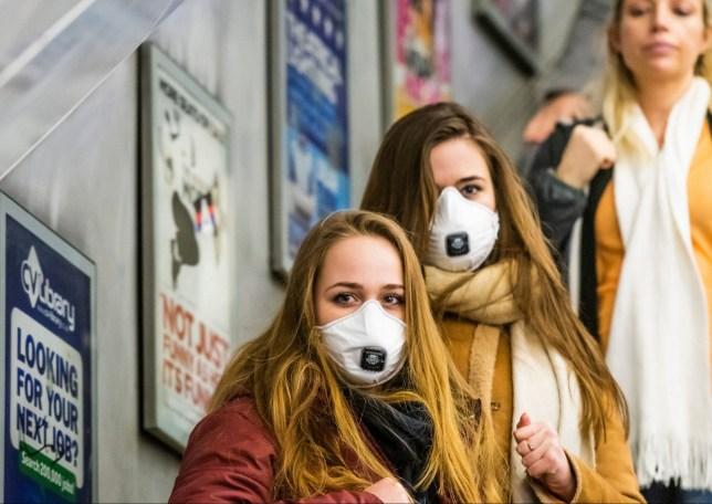 Women wearing masks on the tube