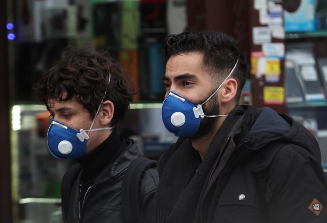 People wearing face masks in east London. PA Photo. Picture date: Saturday March 7, 2020. See PA story HEALTH Coronavirus. Photo credit should read: Yui Mok/PA Wire