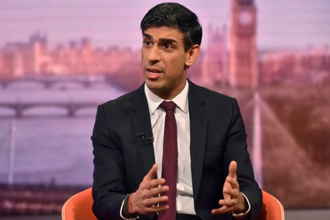 In this handout picture released by the BBC on March 8, 2020, Britain's Finance minister (Chancellor of the Exchequer) Rishi Sunak talks with host Andrew Marr (unseen) during an appearance on the BBC political programme The Andrew Marr Show in London. - Britain unveils its first post-Brexit budget on Wednesday and analysts expect Prime Minister Boris Johnson to press ahead with major spending on infrastructure, despite the economic fallout from the coronavirus. Finance minister Rishi Sunak, who will present the budget after his predecessor Sajid Javid resigned unexpectedly last month, is also scheduled to outline emergency funding measures in the battle against COVID-19. (Photo by JEFF OVERS / BBC / AFP) / RESTRICTED TO EDITORIAL USE - MANDATORY CREDIT
