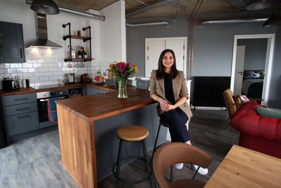 WEMBLEY PARK, LONDON, MARCH 9TH 2020. WHAT I RENT: WEMBLEY PARK Tenant Deepika Sharma is pictured in the open plan living room and kitchen of her two-bedroomed flat in Wembley Park, London, March 9th 2020. Deepika and her flatmate pay ?1200 a month each which included all utility bills, gym membership and communal area access but excludes council tax. Photo credit: Susannah Ireland