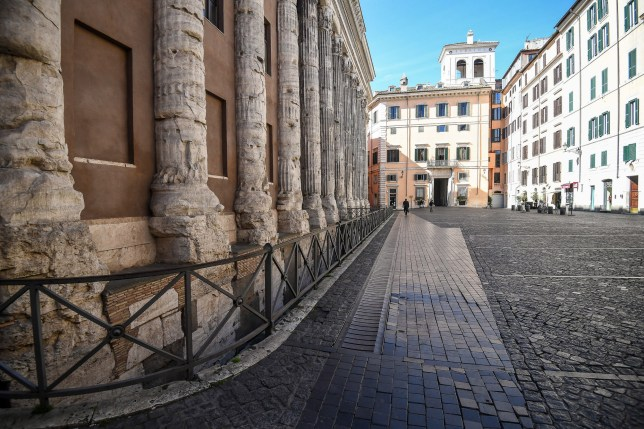 A view of the semi-deserted Piazza di Pietra square in the center of Rome, Italy