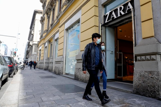 epa08283526 A man wearing a protective mask walks by a Zara store in Corso Buenos Aires, an important commercial street in Milan, with over 350 stores selling various types of goods, Milan, Italy, 10 March 2020. In an attempt to stop the spreading of the novel coronavirus Covid-19, Italian Prime Minister Conte announced on 09 March the extending of coronavirus quarantine measures to the entire country starting on 10 March until 03 April. It will be possible to move only for 'proven work reasons' or 'serious family or health needs', he said. All public gatherings have been banned and people have been advised to stay at home. EPA/Mourad Balti Touati