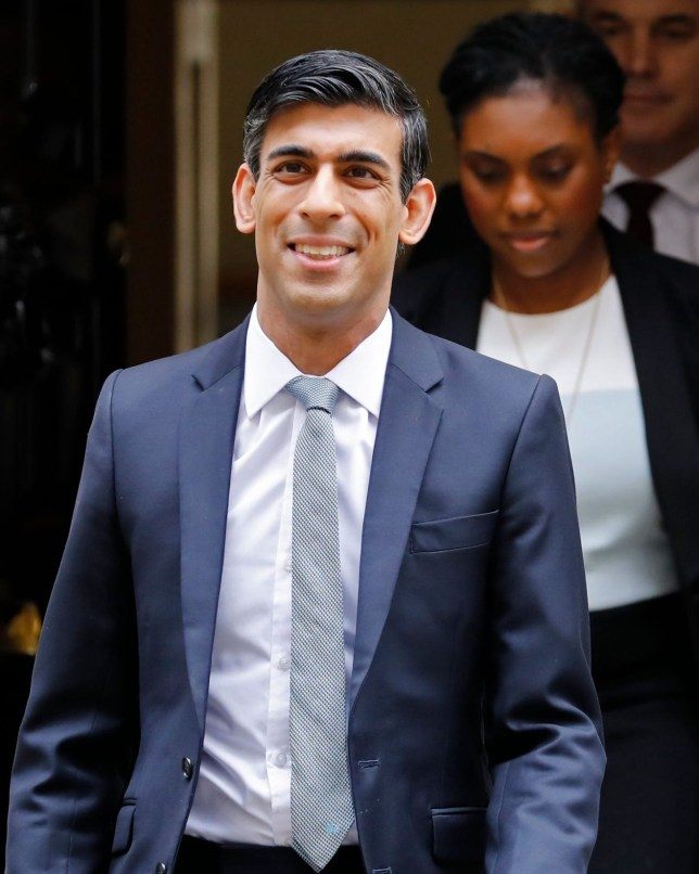 Britain's Chancellor of the Exchequer Rishi Sunak carries the Budget Box as he and his team leave 11 Downing Street on March 11, 2020 ahead of the announcement of Britain's first post-Brexit budget. - Britain unveils its first post-Brexit budget on on March 11, with all eyes on emergency government measures to ease the economic pain from the coronavirus outbreak. (Photo by Tolga AKMEN / AFP) (Photo by TOLGA AKMEN/AFP via Getty Images)