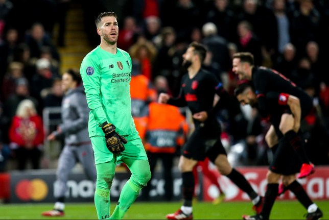 Adrian reacts as Atletico Madrid players celebrate around the Liverpool player