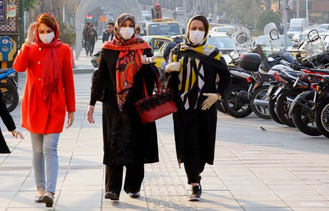 epa08290343 Iranians wearing face masks and protective gloves go shopping in a bazaar during the coronavirus pandemic in Tehran, Iran, 12 March 2020. Media reported the Iranian economic is effected by Covid-19 coronavirus crises as many people started to self-quarantine and to stop going out as much as they can. According to the last report by the Ministry of Health, 10,075 people were diagnosed with the Covid-19 coronavirus and 429 people have died in Iran. EPA/ABEDIN TAHERKENAREH