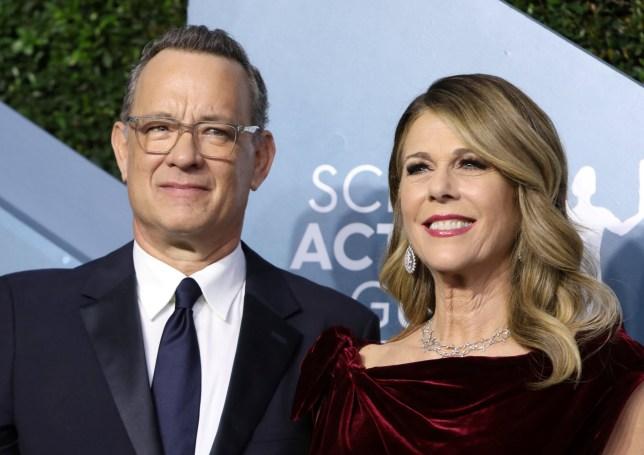 FILE PHOTO: 26th Screen Actors Guild Awards ??? Arrivals ??? Los Angeles, California, U.S., January 19, 2020 ??? Tom Hanks and Rita Wilson. REUTERS/Monica Almeida/File Photo
