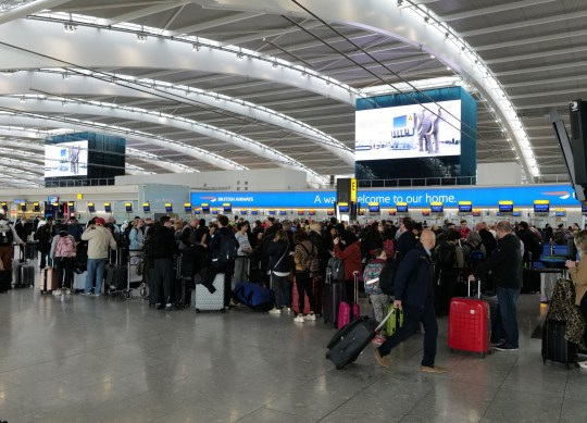 W8media Heathrow airport this morning with the longest Q's seen for over a week as people panic to get back to the Usa before a European flight ban back to the Usa is enforced by the American government. Over 1000 people can be seen at terminal 5 waiting to check in