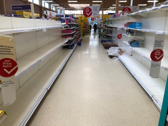 Empty shelves at Tesco in Camelon near Falkirk, as shoppers purchase supplies amid the coronavirus pandemic. PA Photo. Picture date: Sunday March 15, 2020. See PA story HEALTH CoronavirusRetail. Photo credit should read: Andrew Milligan/PA Wire