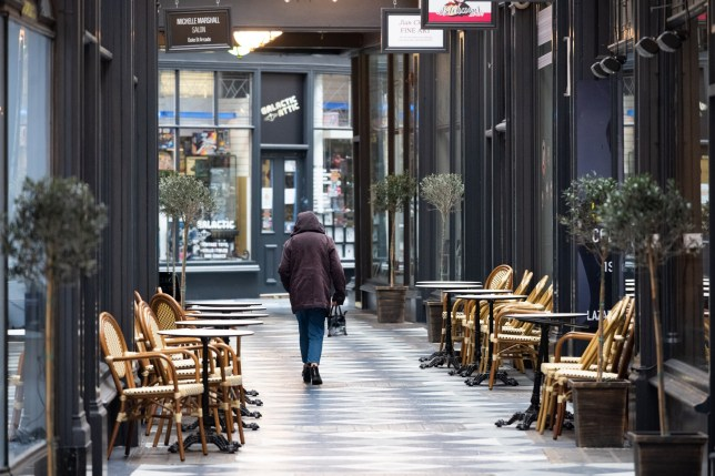 CARDIFF, UNITED KINGDOM - MARCH 17: A woman walks through an empty Duke Street Arcade, home to many small businesses, on March 17, 2020 in Cardiff, Wales. Boris Johnson held the first of his public daily briefing on the Coronavirus outbreak yesterday and told the public to avoid theatres, going to the pub and work from home where possible. The number of people infected with COVID-19 in the UK reached 1500 today with 36 deaths. (Photo by Matthew Horwood/Getty images)