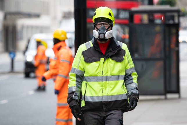 A construction worker wearing a protective face mask amid the coronavirus pandemic