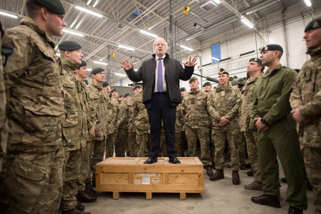 Prime Minister Boris Johnson addresses British soldiers after serving Christmas lunch to British troops stationed in Estonia during a one-day visit to the Baltic country. PA Photo. Picture date: Saturday December 21, 2019. The Prime Minister thanked the servicemen and women for their work as he joined them for lunch at the Tapa military base near the capital Tallinn. The base is home to 850 British troops from the Queen's Royal Hussars who lead the Nato battlegroup along with personnel from Estonia, France and Denmark. See PA story POLITICS Estonia. Photo credit should read: Stefan Rousseau/PA Wire