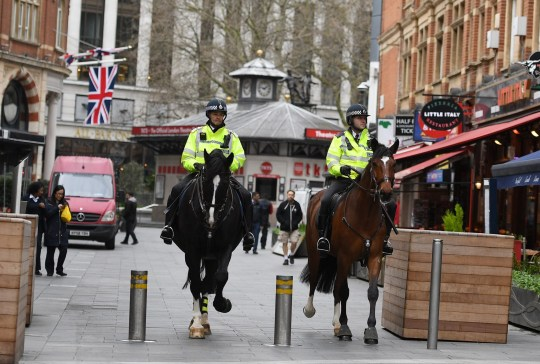 Mandatory Credit: Photo by Beretta/Sims/REX (10587998o) Police on horses in London's Leicester Square Coronavirus outbreak, London, UK - 19 Mar 2020